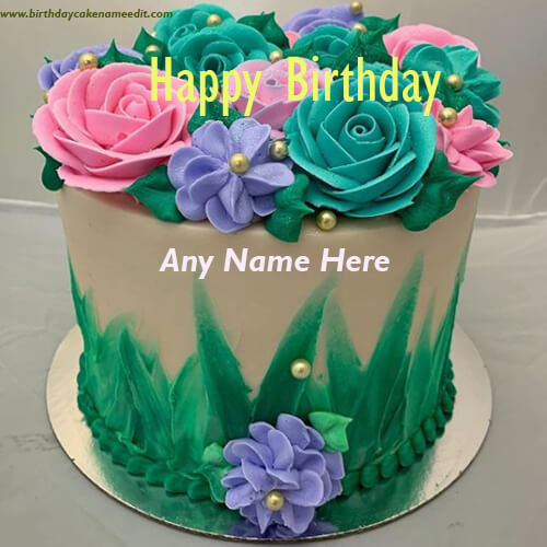 Multicolored Flower Decorated Happy Birthday Cake with Name